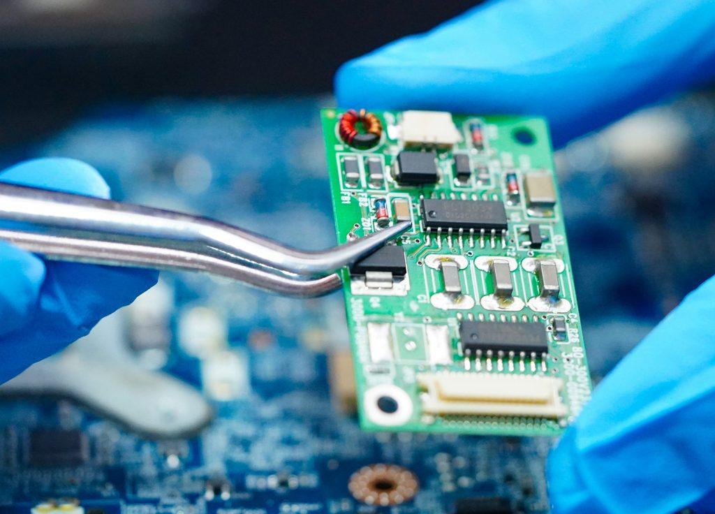 tech holding a circuit board